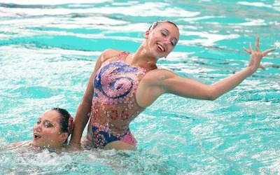 Malaysia's Shareen Png Hui Chuen and Katrina Ann Abdul Hadi competes in the synchronize swimming duet free finals event at the aquatics stadium in Jakabaring in Palembang, Nov 20, 2011. They won the gold medal. GLENN GUAN/The Star (Palembang)